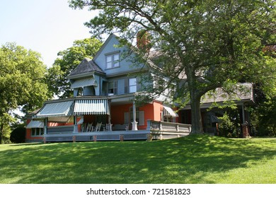 back yard lawn and old wooden residential home with porch