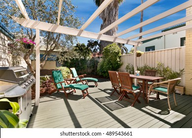 back yard with outdoor seating and barbecue with family