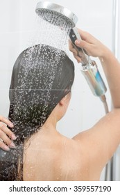 Back of young beauty woman under shower
