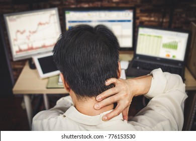 Back of young business people are suffering from headaches. Asian men stressful working with computer for a long time. Office syndrome concept