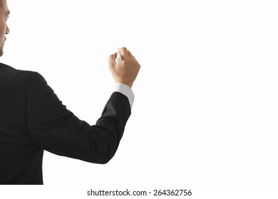 Back of young man in a suit writing or drawing something  Isolated white background
