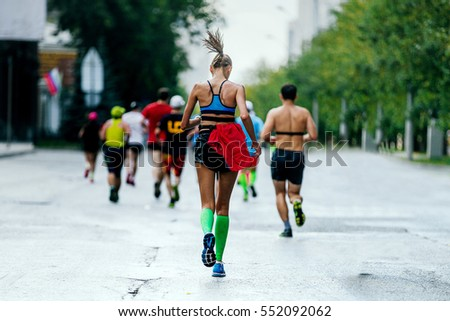 b0bf24de49 back young woman runner running in city marathon compression socks