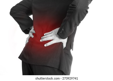 Backache ,Businessman holding hand at Back of body cause of pain back area after finished work in Office.