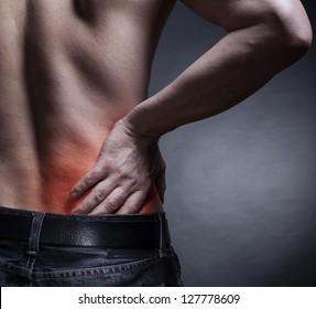 Backache. Pain in the lower back. Man's back