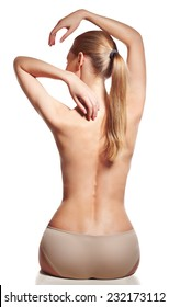 Backache. Young female with naked back having spine problem. Backbone Pain.