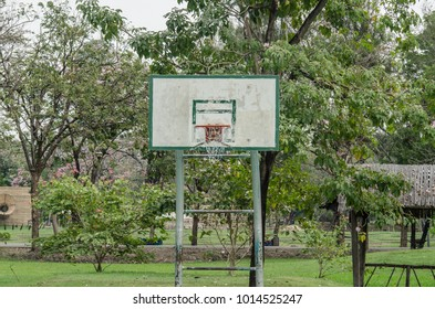 A backboard in a park for people play basketball.
