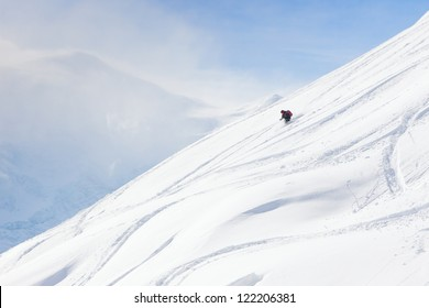 Back-country skier on wide open slope.