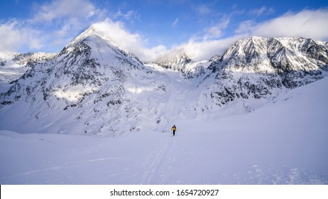 Backcountry Skier Surrounded by Spectacular Peaks of Austrian Alps
