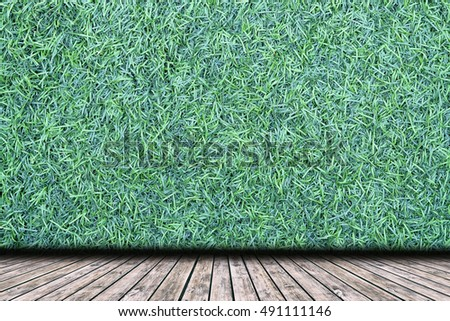 backdrop artificial grass wall against wooden stock photo edit now