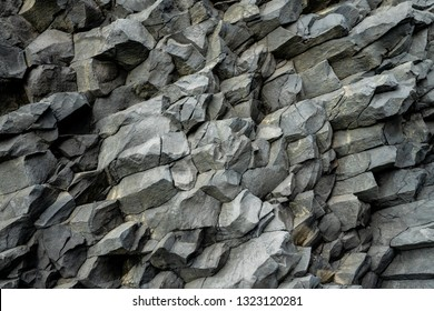 Backdrop from basalt volcanic rock formations in Reinisfjara beach near Vik in northern Iceland