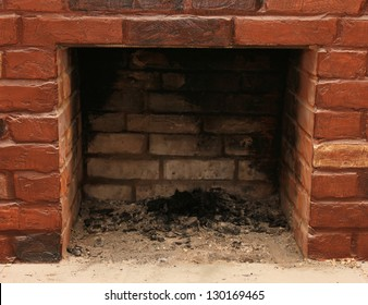 Backdrop of a brick fireplace wall in a vacant setting
