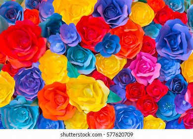 Backdrop of colorful paper roses background decorated on a wall.
