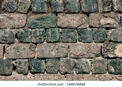 Backdrop of an old industrial wall made from greeen slag or cinder stones