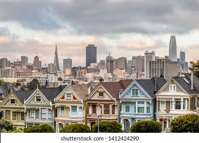 Backed by the city of San Francisco, California, the Victorian era houses near Alamo Square Park, are painted in multiple colors to accentuate their architectural details.