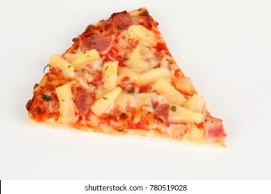 a backed pizza with pinapple and ham