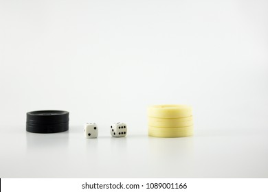 Backgammon black and white chips and dice