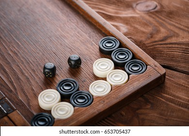 Backgammon. Game field in a backgammon with cubes and counters. Game concept. Board game. Hobby. Dice and checkers on the playing field for a game of backgammon.