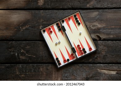 backgammon lie on an old wooden table, backgammon game