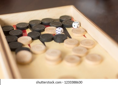 backgammon pieces and dices on a backgammon board leisure concept