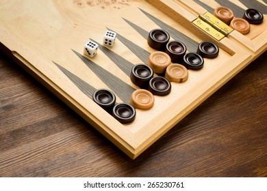 Backgammon set with dice on wooden background