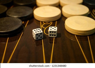 Backgammon Table Game Board. Color detail of a Backgammon game with two dice. Board game backgammon