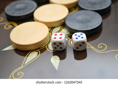 Backgammon Table Game Board. Color detail of a Backgammon game with two dice. Board game backgammon. Selective focus
