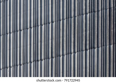 Backgrond image of sheets of aluminum on a wall.