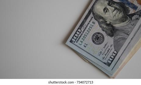 Background of 100 dollar bills close-up.