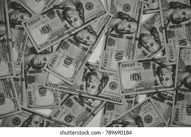 Background of 100 dollar bills. A lot of dollar bills scattered on a white background. Isolated. Money concept