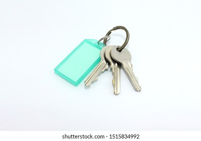 isolated the door keys and green tag on white background.