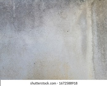 The metal texture of surface wall concrete damaged by rusty forv background. Wall concrete isolated colors for background