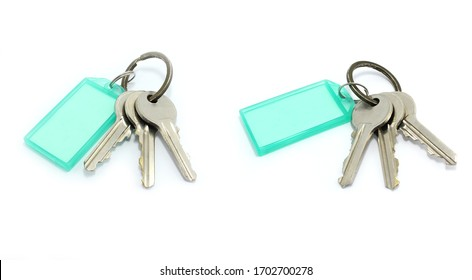 isolated​ the​ door​ key​s​ and​ green​ tag​ on​ white​ background.