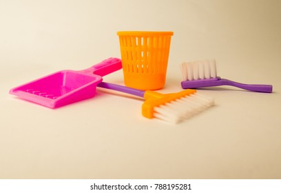 Background about the order in the nursery with colored toy bucket, shovel and broom