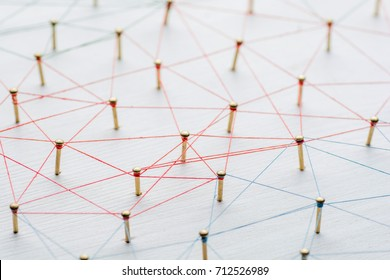 Background. Abstract concept of network, social media, internet, teamwork, communication. Nails linked together by threads.