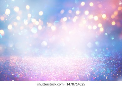 background of abstract glitter lights. blue, pink, gold and silver. de focused