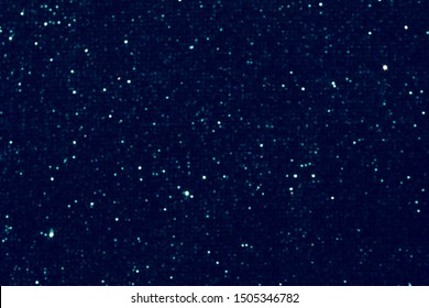 background of abstract glitter lights. blue and black. de focused