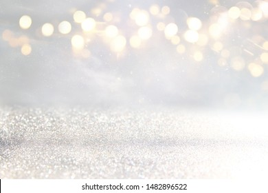 background of abstract glitter lights. silver and gold. de-focused