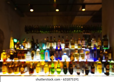 Background Abstract shelves with different bottles of alcohol