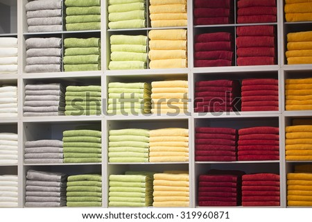0b35cb8e1 Background of accurate colorful shopping showcase of shelf with many fluffy  bathing towels white grey green