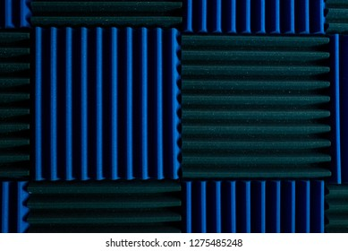 Background of acoustic blue foam insulation in musical recording studio.