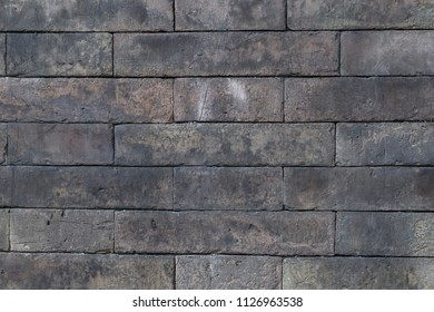 Background of aged grey color brick wall texture