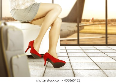 background of airport and red heels woman legs and free space
