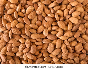 Background of almonds closeup. The nuts