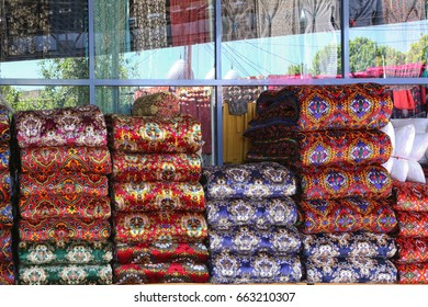 Background of amazing multicolored Uzbek ornaments on fabric in a street bazaar
