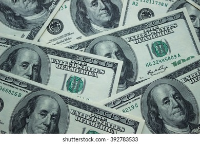 Background of American 100 dollar banknotes, close up view of cash money dollars bills in amount