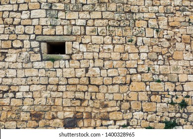 background of ancient town wall of Ostuni town, Italy