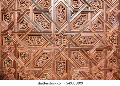 Background of arabic decoration on carved wood. Alhambra of Granada. Spain