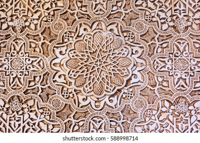 Background  of arabic decoration in plaster. Alhambra of Granada. Spain