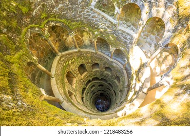Background architecture. The Masonic Initiation well, the spiral staircase of Quinta da Regaleira in Sintra, Portugal.