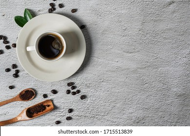 Background with assorted coffee, coffee beans, pads and capsules, retro style toned, copy space, top view.